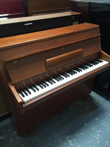 Zender 6octave upright in a mid mahogany casework